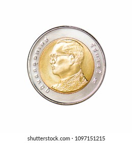 Thailand Ten baht coins isolated over white background,the reign of King Rama 9 appears on the coins, front