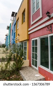 in Thailand these beautiful colored houses are in the street