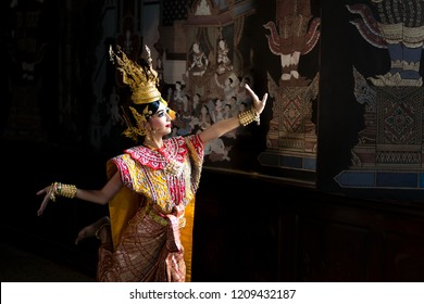 Thailand traditional or cultural dance in Thai costume. Thai beautiful girl is dancing called Nang Ram, it is noble Thai art of elegance.