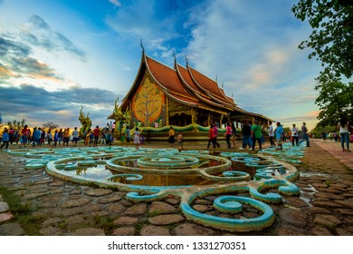 Thailand - Ubon Ratchathani: 30 December 2018: Thais bring families to visit Sirinthorn Wararam Phupha Temple (Wat Phu Phrao) in the evening. Very beautiful temples near the Thai-Lao border town of Ch