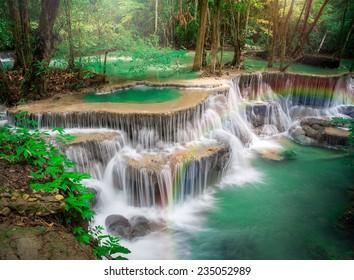 Thailand waterfall in Kanchanaburi (Huay Mae Kamin) with rainbows