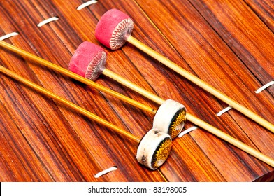 """Thailand Xylophone that it called """" Ranat ek""""  Thai xylophone. It has 21 or 22 wooden bars suspended by cords over a boat-shaped trough resonator, and is played with two mallets."""