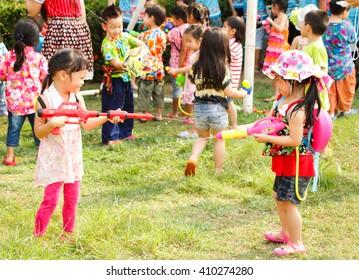 THAILAND,APRIL 2016: Asian little girl plays water gun in Songkran festival at Panjasap Minburee school  Bangkok,Thailand