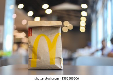 Thailand-April2019:  The takeout packaging paper bag for McDonald's was placing on the table, customer will get this for take home food. Illustrative Editorial product photo