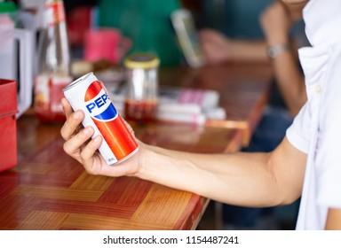 THAILAND-BANGKOK -AUGUST-7-2018:Man hand holding of Pepsi anniversary 120 years: pepsi generations, logo of pepsi