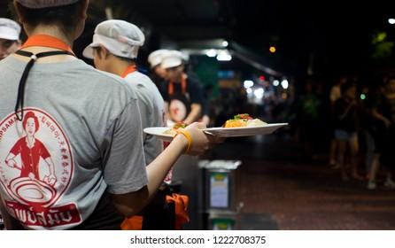 Thailand,Bangkok-November 6,2018:The waiter is serving padthai at Tipsamai restaurant, the most popular padthai restaurant in Thailand