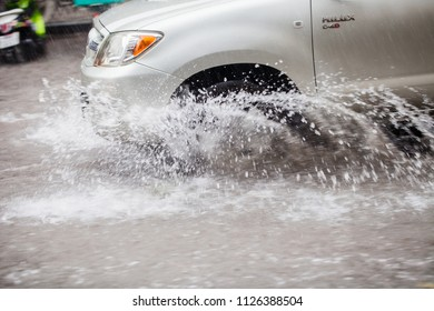 THAILAND,JULY 2018 2: Traffic on a road with water because of heavy rain and drainage in Udonthani,Thailand