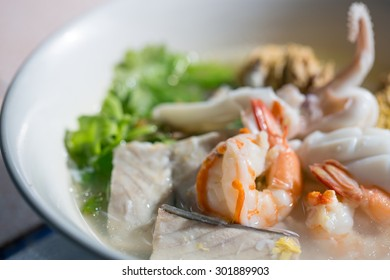 Thai-style seafood boiled rice, soft background