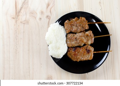 Thai-styled grilled pork and sticky rice. It's among most popular street foods in Thailand