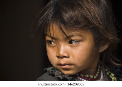 THAKURDWARA, NEPAL - FEBRUARY 06  Unidentified Tharu girl chid portrait on february 6, 2010 in Thakurdwara village, Bardia district, Nepal. Tharu are an ethnic group from west part of Nepal,