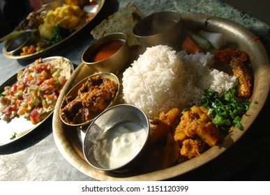 Thali is the Indian name for a round platter used to serve food. Thali is also used to refer to an Indian-style meal made up of a selection of various dishes which are served on a platter.