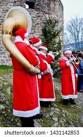 Thallichtenberg, Germany - December 2012 Four men dressed as Santa play brass instruments at Lichtenburg castle at a Christmas market (Weihnachtsmarkt).