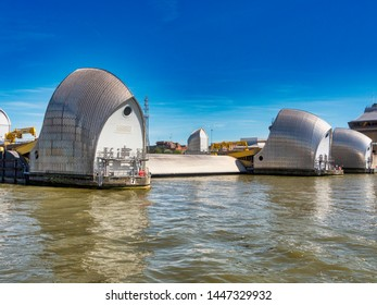 Thames Barrier, London, July 2019; River Thames Flood Prevention Barrier - one barrier in raised position for maintenance; editorial use only