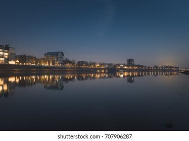 Thames reflection of building at dusk, Fulham, London