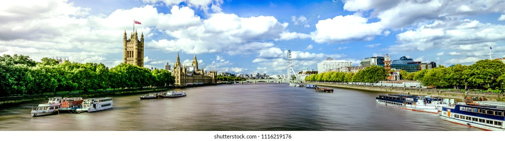 Thames River panorama and London eye with Westminster Palace in London.