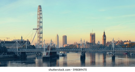 Thames River panorama with London Eye and Westminster Palace in London.