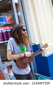 Thames/New Zealand - August 17, 2013: Musician busking at the Thames Market Day.