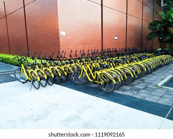 Thammasat university, Bangkok / Thailand - June 24, 2018 : Rows of bikes are placed beside the building. Public bicycle service system by mobile application  serve people who ride the bike to health.