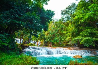Than sawan Waterfall, Payao, Thailand, Normal shot, Beautiful green waterfall in the nature at sunset.
