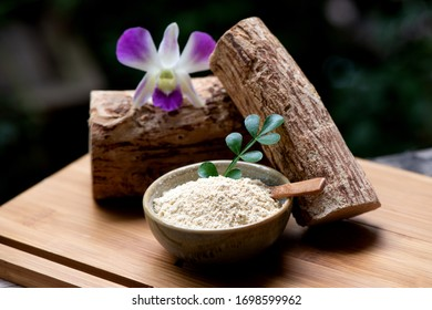 Thanaka or Hesperethusa crenulata, logs, powder and green leaves on a natural background.