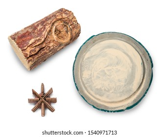 Thanaka wood isolated on white background, Thanaka wood and Kyauk pyin stone slab. Tanaka is Burmese tradition cosmetic made from bark of tanaka tree.