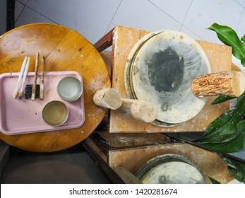 Thanaka wood and Kyauk pyin stone slab. Tanaka is Burmese tradition cosmetic made from bark of tanaka tree