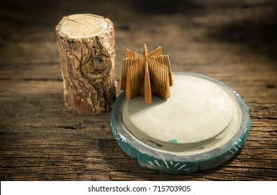 Thanaka wood and Kyauk pyin stone slab. Tanaka is Burmese tradition cosmetic made from bark of tanaka tree.