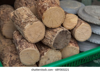 Thanaka wood on sale at street stall in Yangon, Myanmar. Thanaka bark is used to make a traditional yellow cosmetic powder that Burmese people apply on a face for skin protection from sun light.