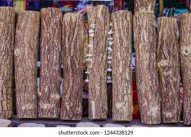 Thanaka wood for sale at rural market. Tanaka is Burmese tradition cosmetic made from bark of tanaka tree.