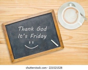 Thank god ,It's Friday  on chalkboard with coffee cup