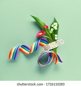Thank you doctors and nurses! Rainbow ribbon and bouquet of red primrose and lily of the valley flowers attached with medical aid patch. Creative panoramic flat lay, green mint background, copy-space.
