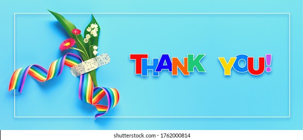 Thank you doctors and nurses! Rainbow ribbon and bouquet of red primrose and lily of the valley flowers attached with medical aid patch. Creative panoramic flat lay, blue mint background, text