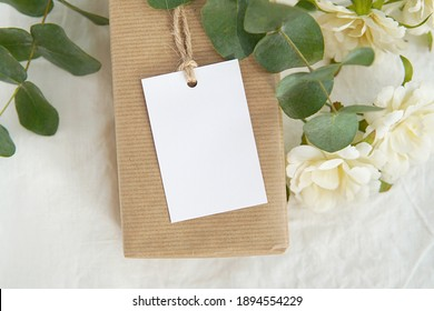 Thank you gift tag mockup for wedding, bridal shower, rustic wedding favor tag, rectangle  label mock up on kraft paper box, eucalyptus branches, white flowers. - Shutterstock ID 1894554229