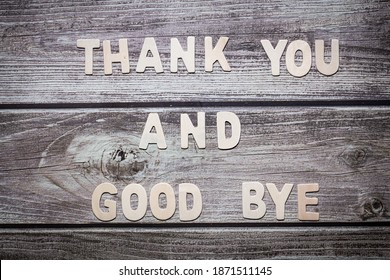 Thank you and good bye wooden words letter written on a wooden board