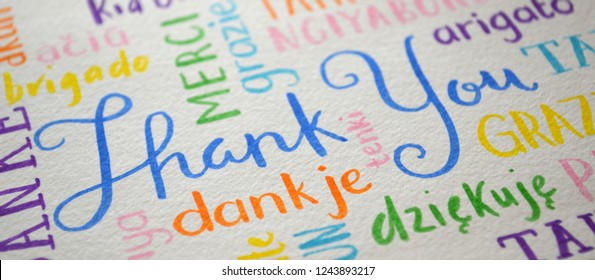 THANK YOU handwritten banner with translations into various languages