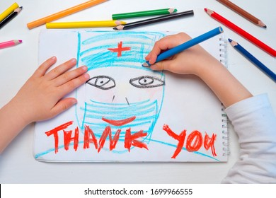 Thank you hospital workers. Coronavirus doctors thank you. Child sends message of gratitude thanks to doctors and nurses. Symbol of hope during Covid-19 outbreak. Healthcare workers