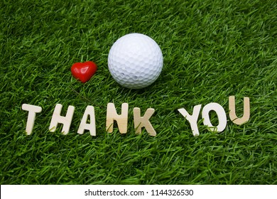 Thank you lettering with golf ball are on green grass for golfer thank you concept