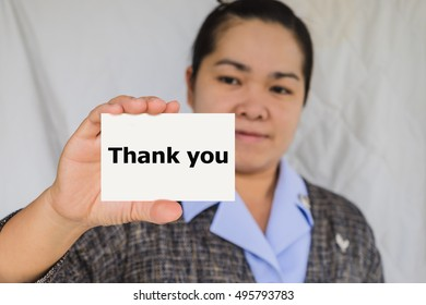 Thank you, message on the card shown by a businesswoman