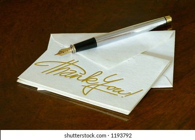 A thank you note with a fountain pen on the image