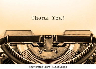 Thank You! printed on a sheet of paper on a vintage printing machine. writer. journalist.