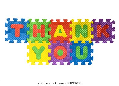 Thank you sign written with alphabet puzzle letters isolated on white background