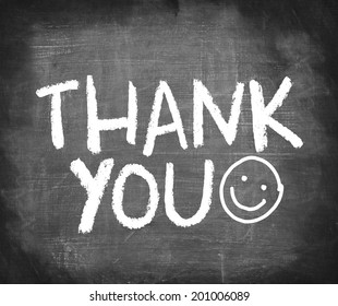 THANK YOU with smiley face handwriting on chalkboard.
