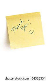 """""""Thank you"""" and a smiley face written on yellow post it note isolated on white background with clipping path."""