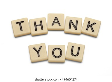 Thank you spelled out with lettered tiles on white background. Clipping path included.
