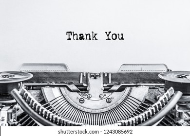 Thank you. The text is typed on a vintage typewriter on a white background. Close-up.