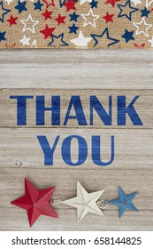 Thank You text with USA red, white and blue stars burlap ribbon on weathered wood