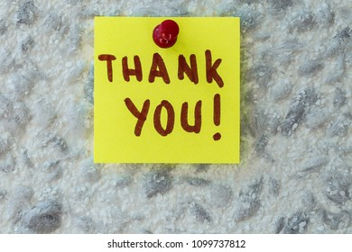 THANK YOU  text written on sticky note on gray background. Motivational quotes