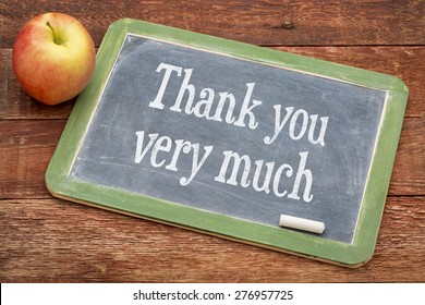 Thank you very much - text on a slate blackboard against red barn wood