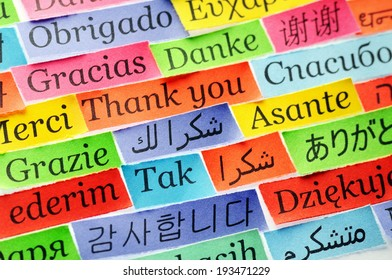 Thank You Word Cloud printed on colorful  paper different languages ,accent on arabic