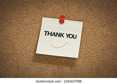 thank you word with smile symbol on notepad